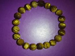 Tiigrisilm - kuldne tiigrisilm - käevõru - fassett-helmed